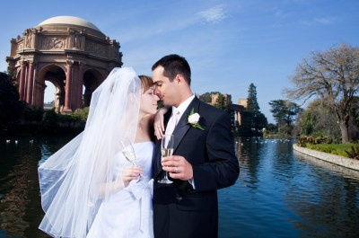 Bride and groom with champagne at Palace of Fine Arts