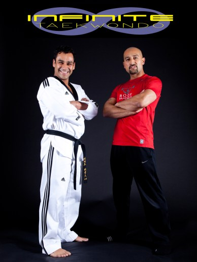 Two male Tai Kwon Do experts standing arms crosse