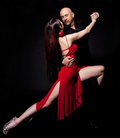 Couple of tango dancers in a dramatic pose