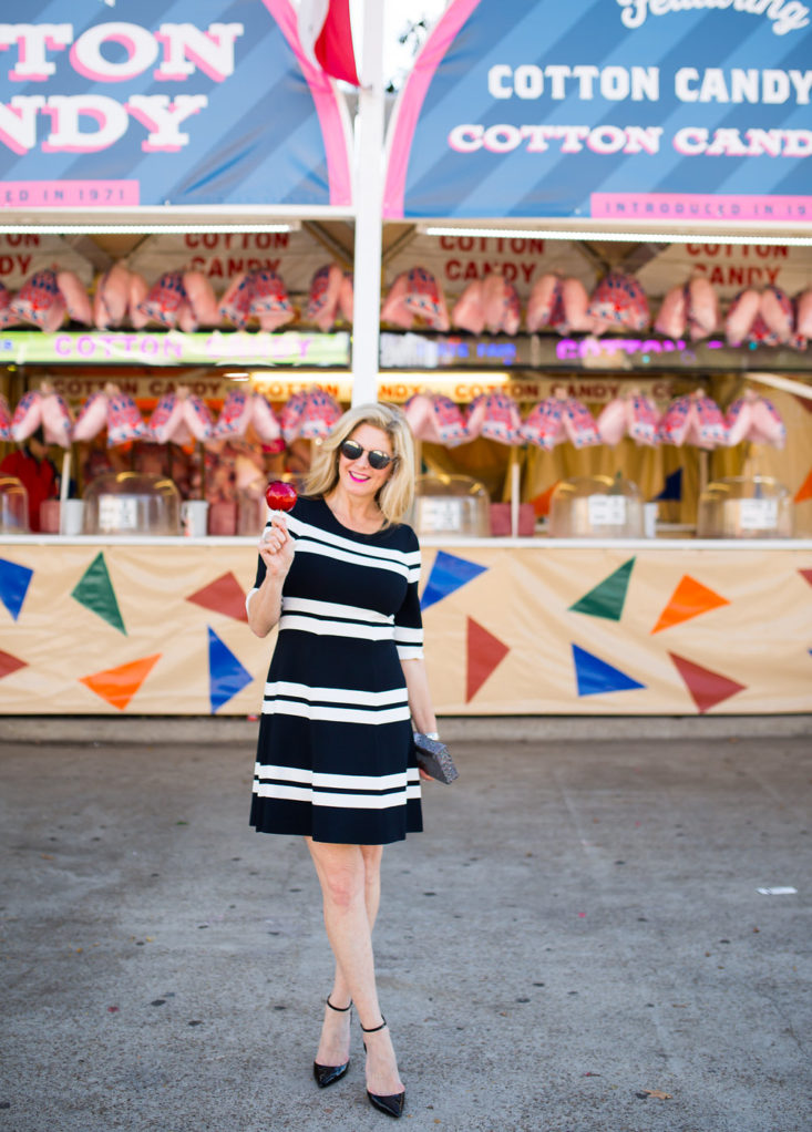 Eliza J striped fit and flare dress at the State Fair of Texas with a candied apple
