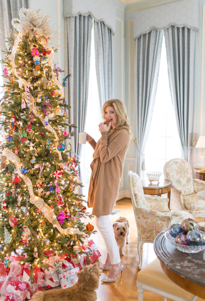tanya foster with christmas tree eating a cookie