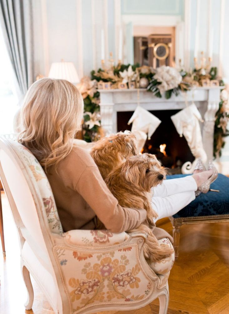 Tanya Foster's decorated home for Christmas. Wearing Nordstrom cashmere sweater with white jeans and t-shirt.