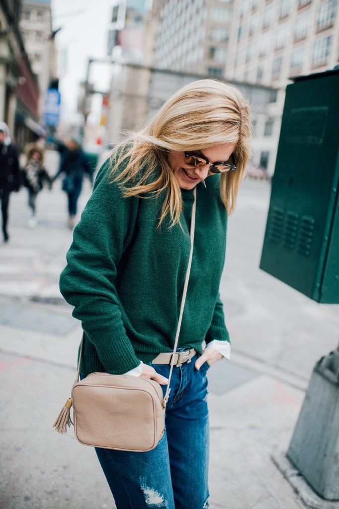 Green sweater, boyfriend jeans, Hermes belt and animal print pumps for NYFW in February 2017