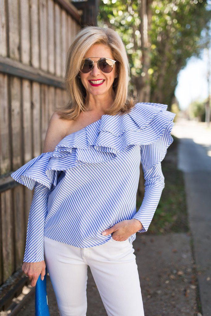 Wearing a blue and white striped shirt from Chicwish with white denim and GiGi New York clutch bag