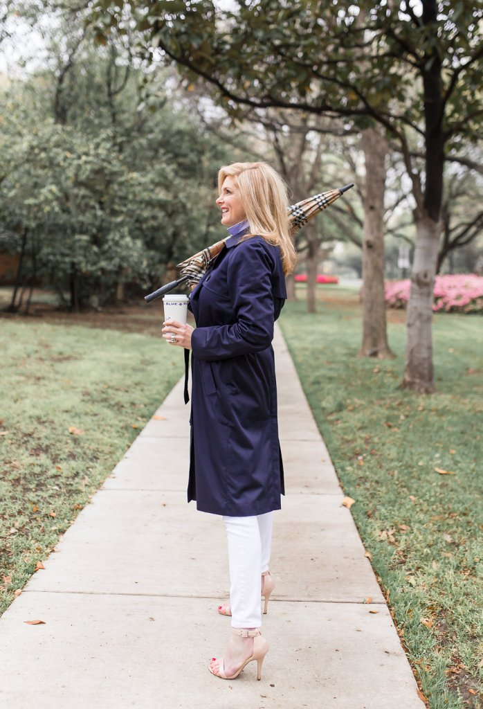 Everlane trench coat and Burberry umbrella for a chic rainy day look.