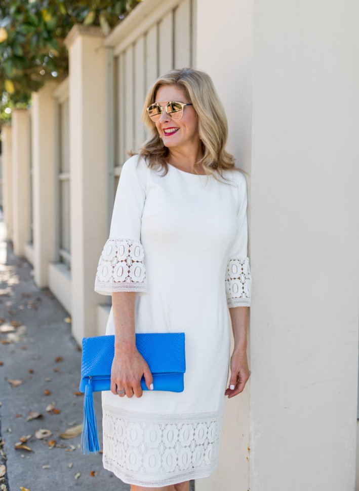 Tanya Foster wears a flounce sleeve shift dress from Talbots with low metallic heels.
