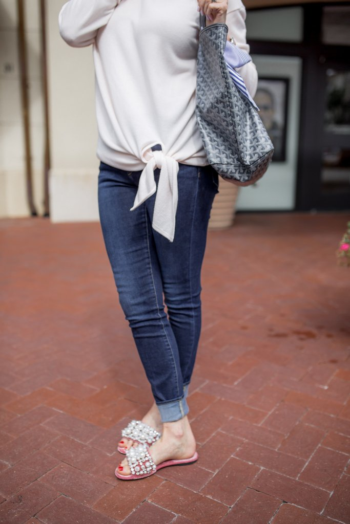 Tie front pullover, skinny jeans and pearl slides from Nordstrom.