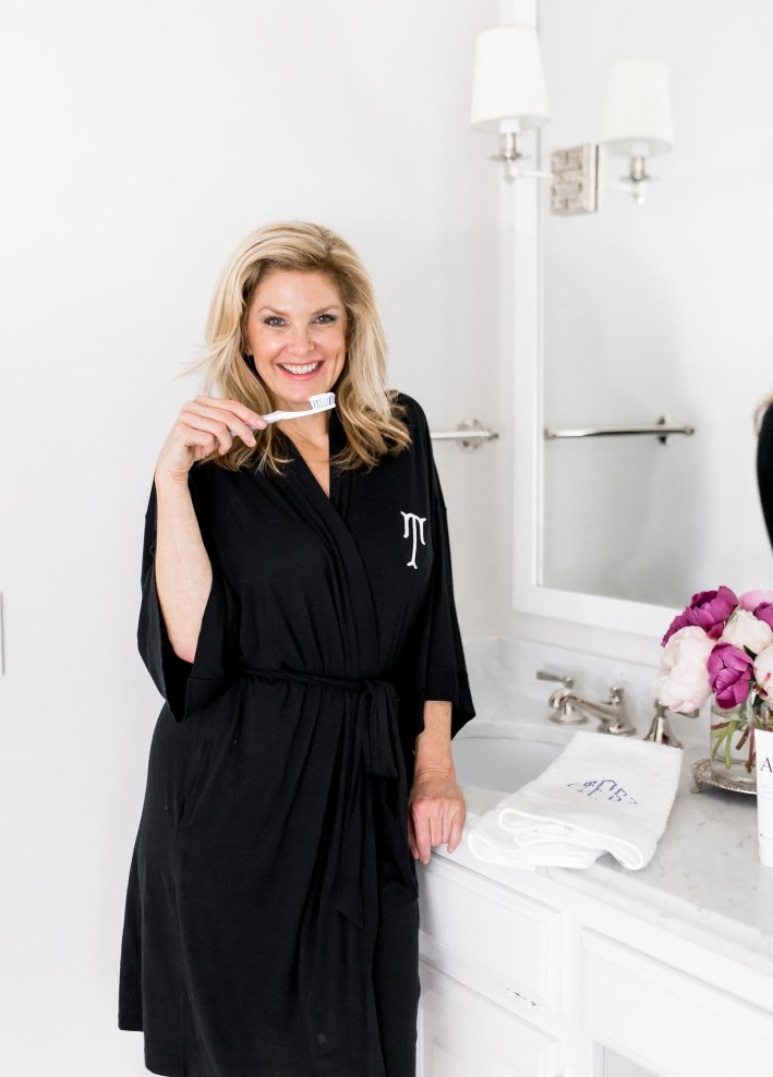 Tanya Foster trying AP-24 whitening fluoride toothpaste to whiten teeth