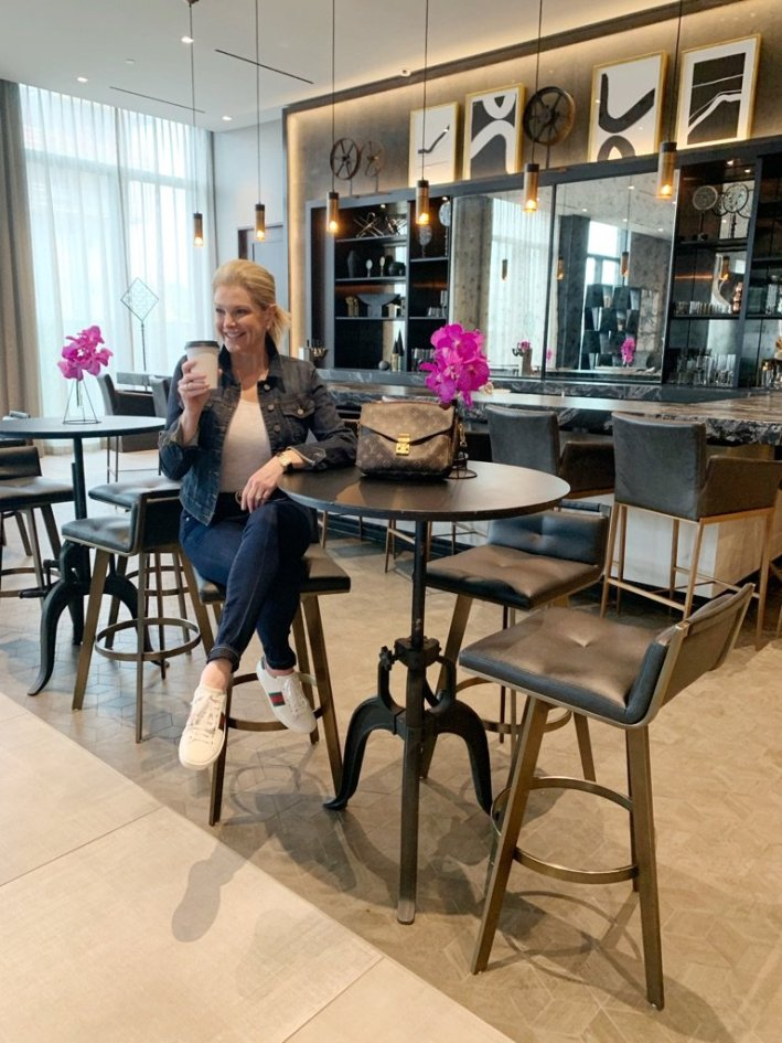 Tanya Foster visits Boston and shares her recommendations | Destination: Boston, Massachusetts Travel Guide by popular Dallas travel blogger, Tanya Foster: image of a woman sitting at a table and drinking a coffee.