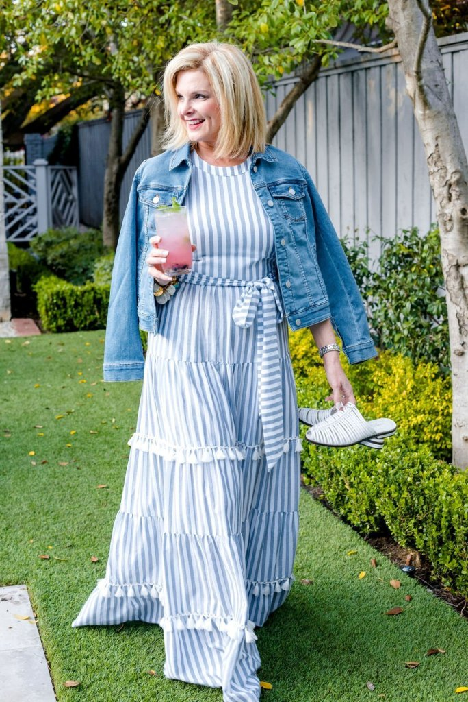 How to style a maxi dress. Eliza J blue and white maxi dress with denim jacket and white shoes.