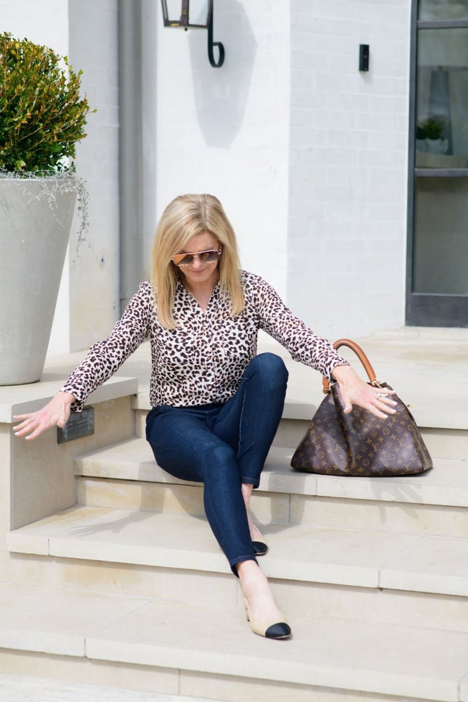 Tanya Foster in an animal print blouse and jeans