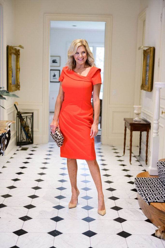 Tanya Foster in a harper rose red dress and officina del poggio leather clutch and nude pointed toe shoes