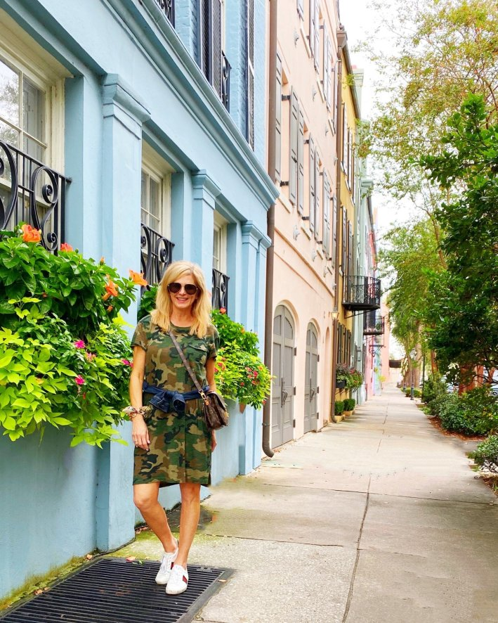 Tanya Foster standing in front of Rainbow Row in Charleston, South Carolina