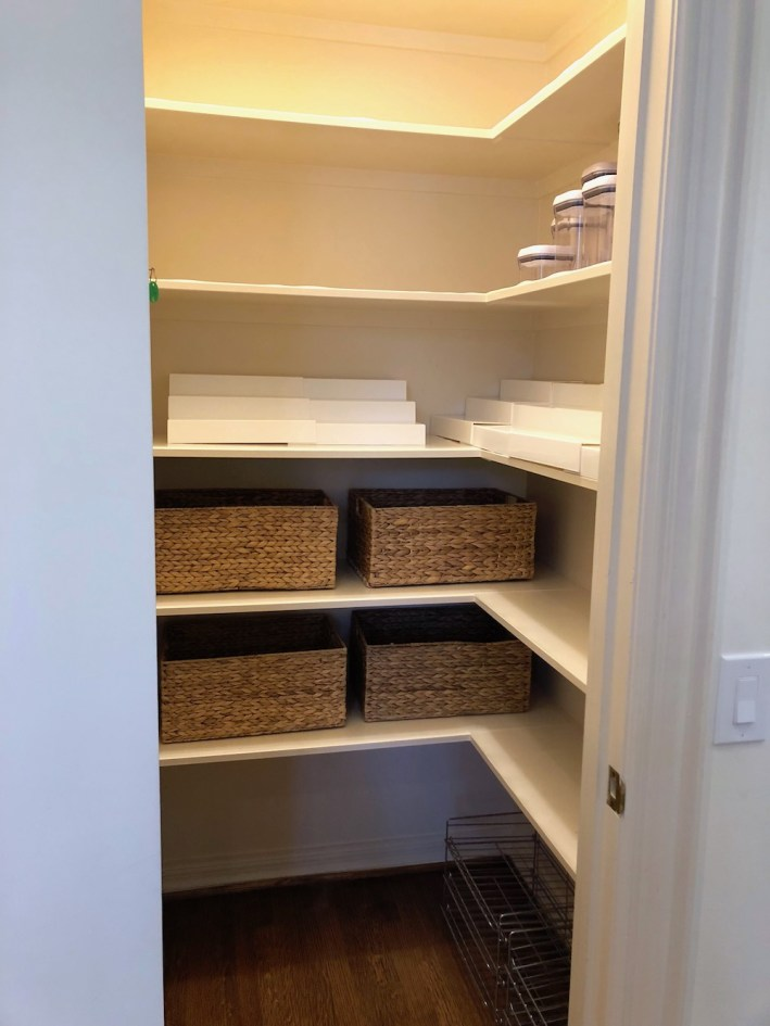 Storage goods from The Container Store help organize a pantry