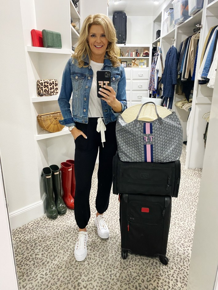 Tanya Foster posing with luggage