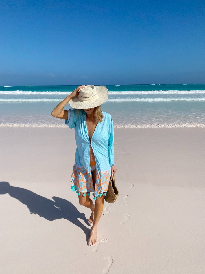 Tanya Foster in Cabana life cover up sun hat and beach bag on the beach