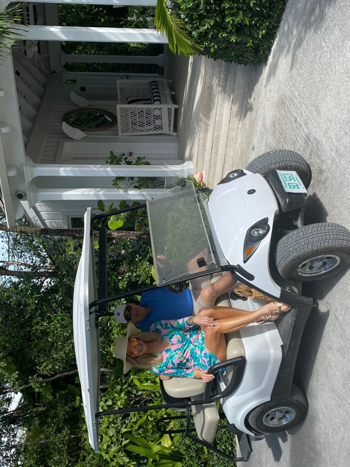 Tanya and Pete Foster in a golf cart -The Dunmore Resort and Harbour Island, Bahamas