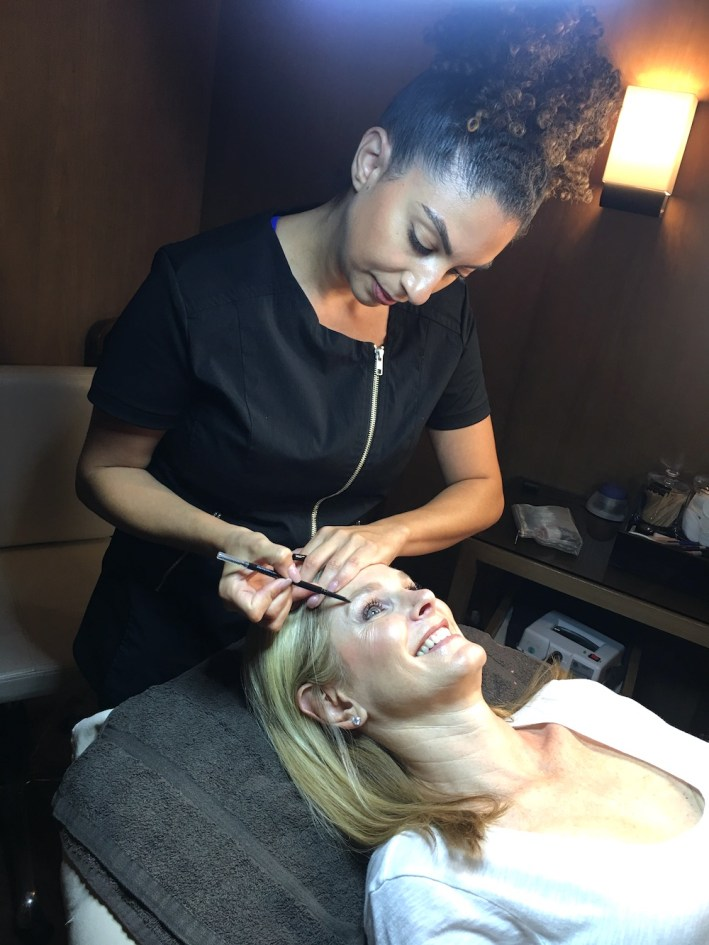Getting your eye brows done with threading with Rula at the Spa at the Joule.