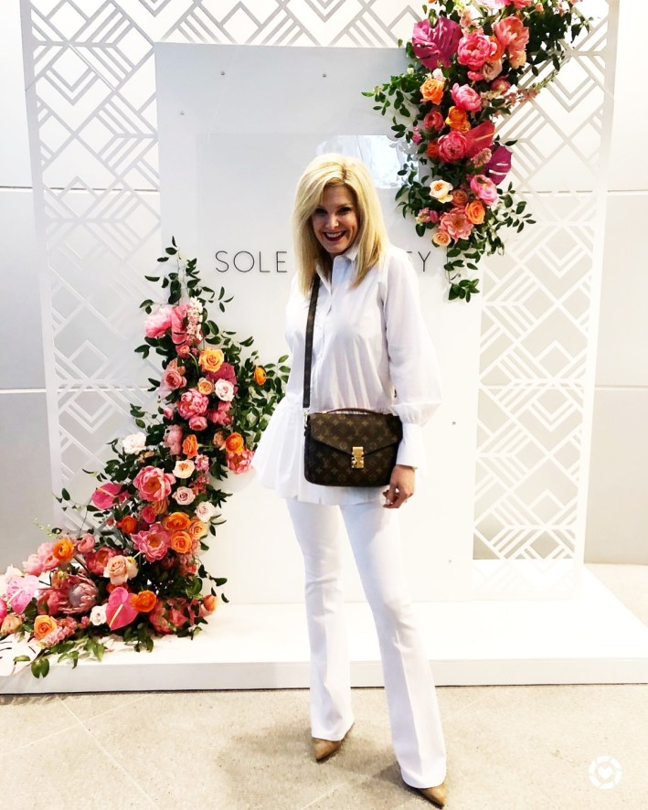 rewardStyle conference 2018, white flare bottom Frame denim jeans, white ruffle H&M top, Louis Vuitton cross body bag