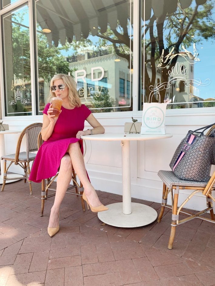 Tanya Foster shows how her Procell Microchanneling helped her skin | Should You Consider ProCell Microchanneling? +Eleven Wellness Giveaway! by popular Dallas beauty blogger, Tanya Foster: image of a woman sitting outside of Bird Bakery at a table a and sipping an iced tea.