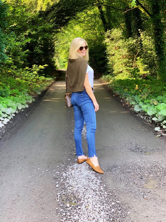 Farnham Estate, Ireland | 8 Reasons to travel to Ireland now! by popular Dallas travel blogger, Tanya Foster: image of a woman walking down a path at Fanham Estate.