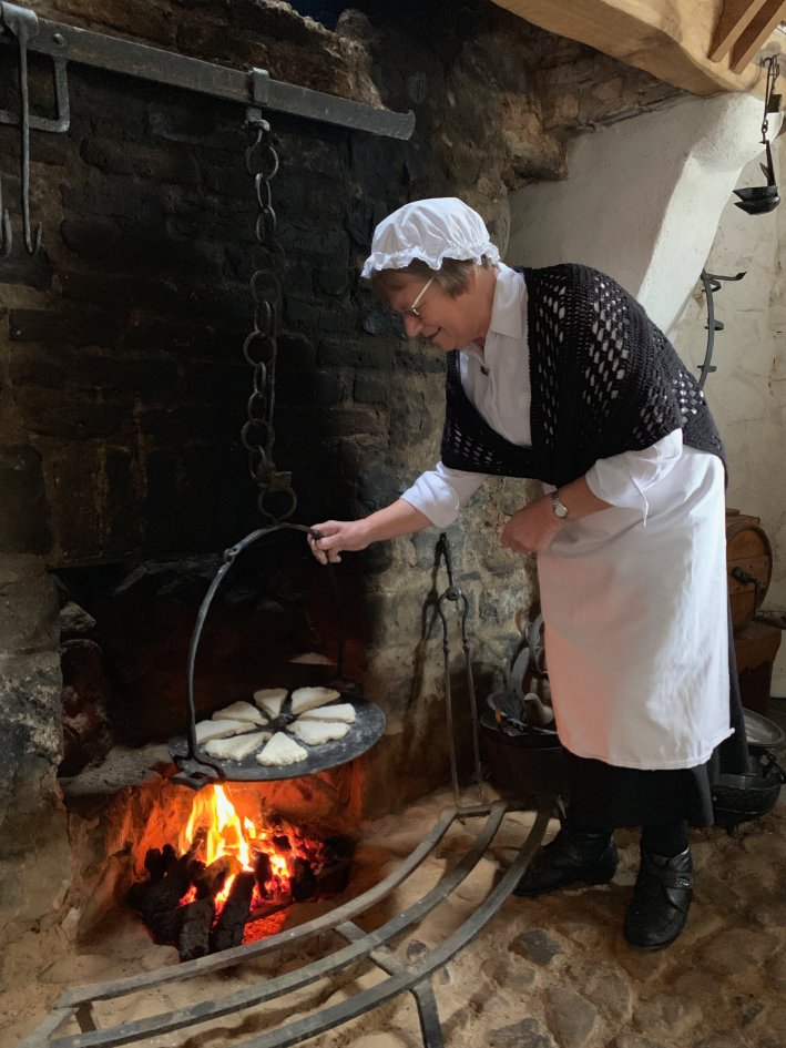 Arthur Cottage | 8 Reasons to travel to Ireland now! by popular Dallas travel blogger, Tanya Foster: image of a woman in period clothing at Arthur Cottage.