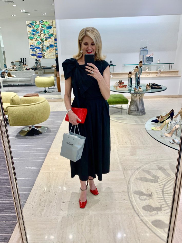 Tips on How to Incorporate Designer Brands For Less Into your Wardrobe featured by top US luxury fashion blogger, Tanya Foster: image of a woman wearing a Carolina Herrera black dress