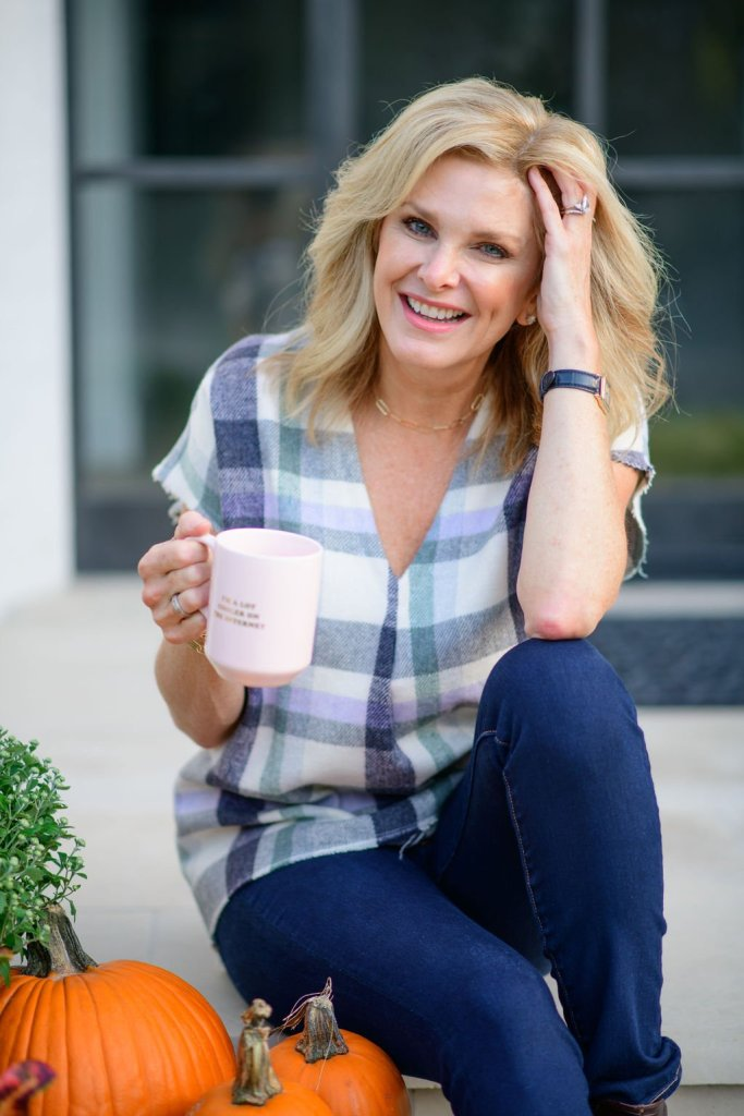 mid-week musing vol. 2 tanya foster holding a coffee cup in JAG look