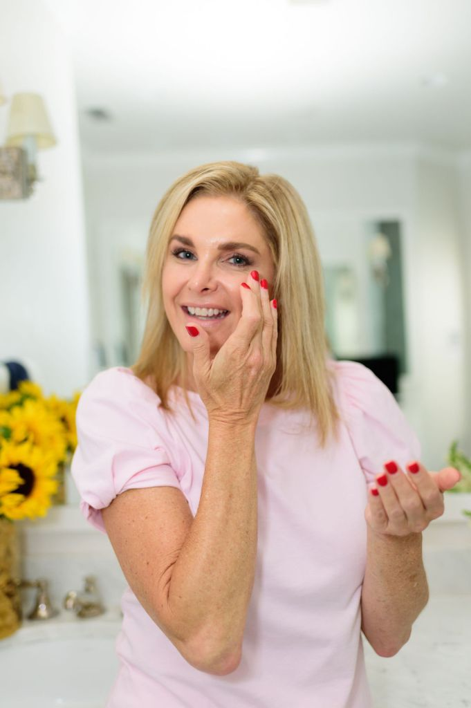 Tanya foster applying beauty product to eyes