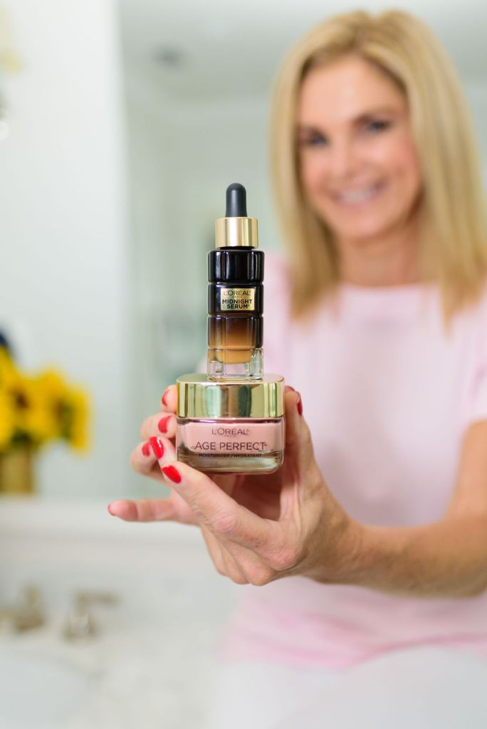 tanya foster holding L'oreal midnight serum and moisturizer