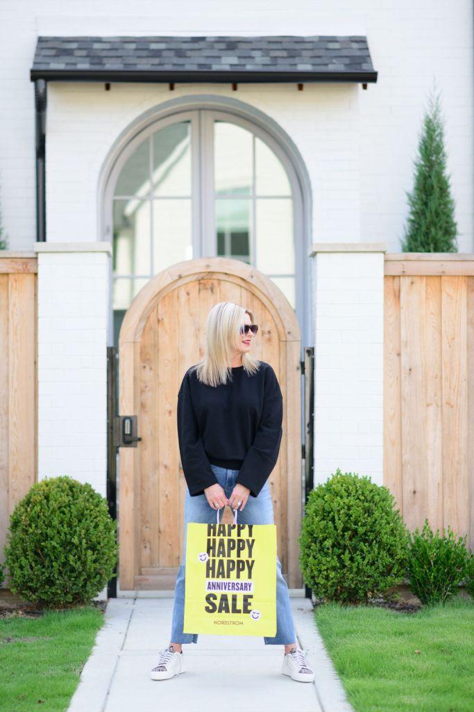 Tanya Foster wearing Good American top BlankNYC jeans and P448 sneakers