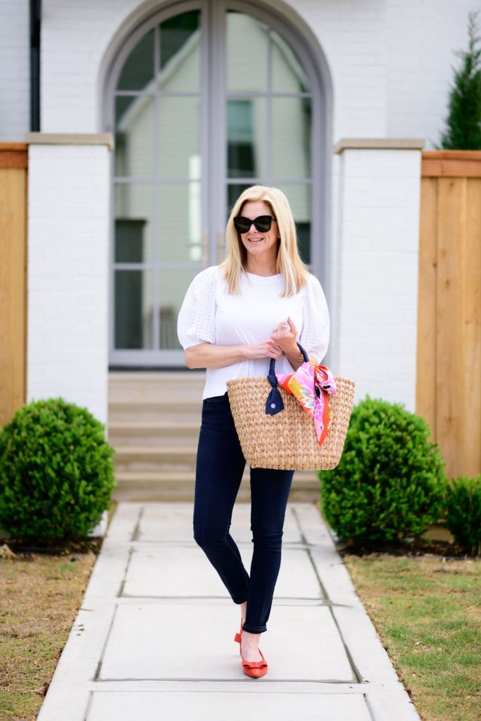 tanya foster wearing loft white blouse with veronica beard skinny jeans and pamela munson bag