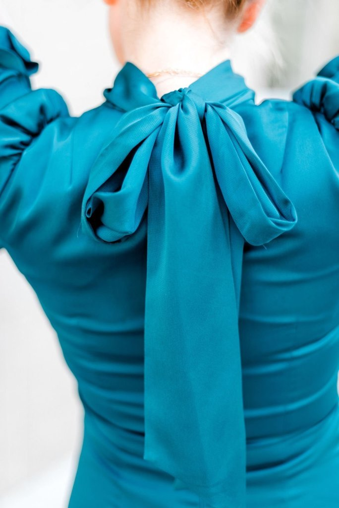 Teal | Fall Color Trend | Fall Color Trends by popular Dallas fashion blogger, Tanya Foster: image of a woman outside wearing a Nordstrom Eliza J. Ruffle Puff Sleeve Dress.