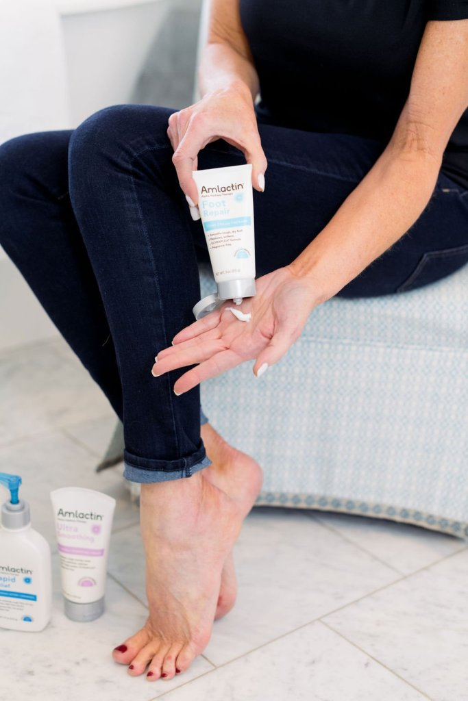 Tanya Foster putting lotion in her hand using AmLactin lotion