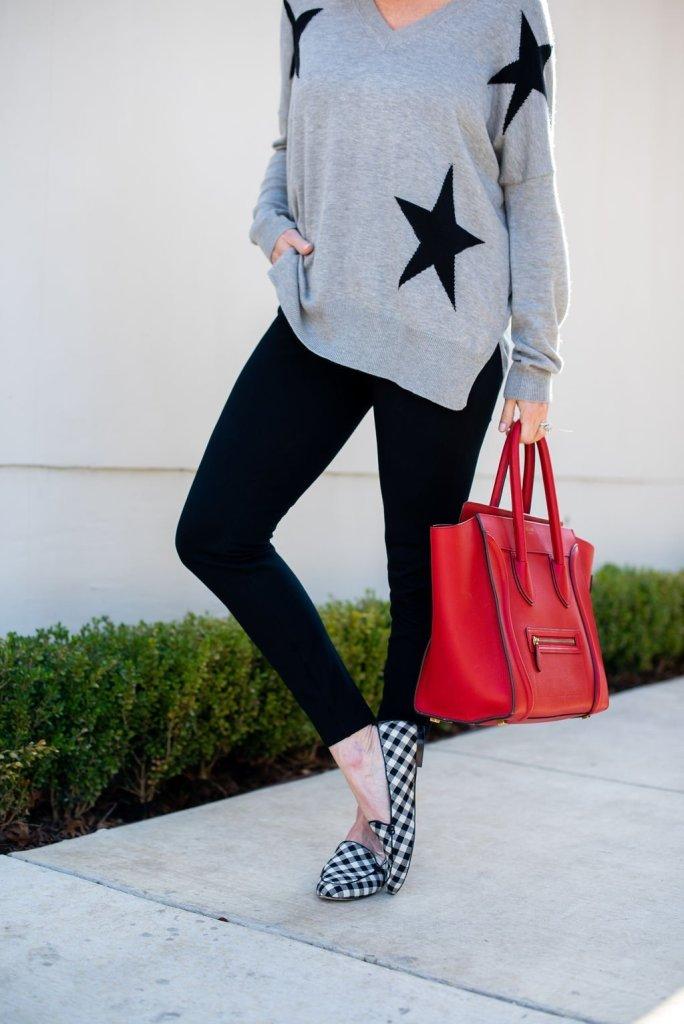 Gray sweater, black pants, red Celine bag