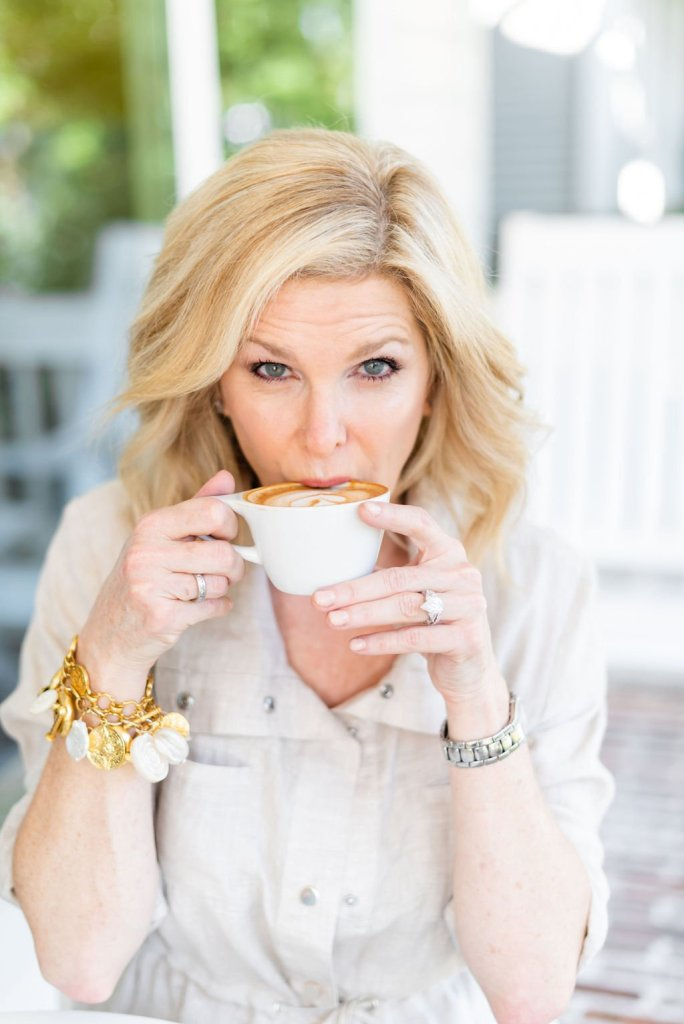 Should You Consider Procell Microchanneling? | Should You Consider ProCell Microchanneling? +Eleven Wellness Giveaway! by popular Dallas beauty blogger, Tanya Foster: image of a woman sitting outside and sipping a latte.