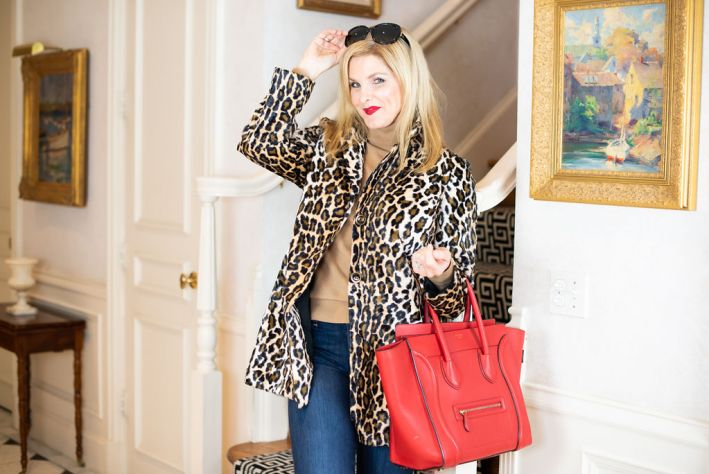 Styling a leopard print jacket from Chico's with flare bottom jeans, neutral turtleneck and red Celine bag
