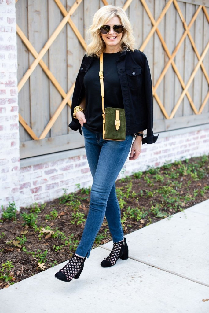 How to Wear a Black Tee 2 Ways by popular Texas fashion blogger, Tanya Foster: image of a woman wearing a Madewell Northside Vintage Tee, AG The Farrah High Waist Ankle Skinny Jeans, Hermes belt, Zappos Cecelia New York Nessa bootie, Talbots CLASSIC JEAN JACKET and Officina del Poggio purse.