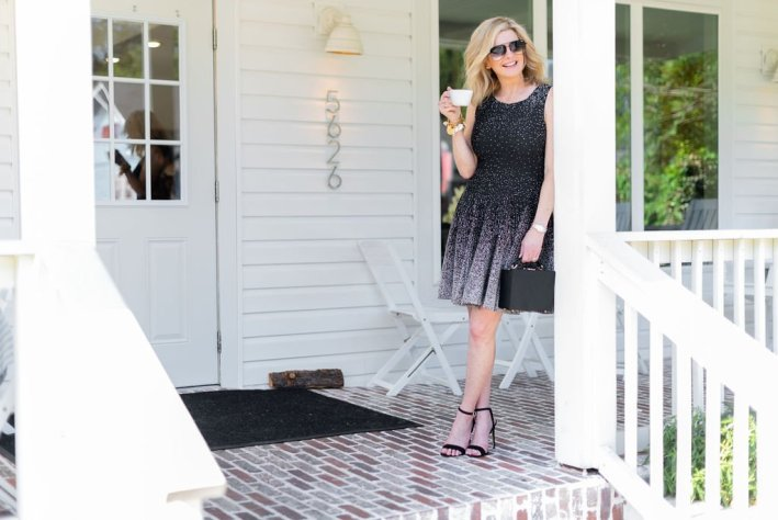 Day to night dresses - Eliza J   Day to night dresses - Eliza J   Best Day to Night Dresses by popular Dallas fashion blogger, Tanya Foster: image of woman standing outside on a porch and wearing an Eliza J Ombré Dot Fit & Flare Sweater Dress and black Stuart Weitzman Nudistsong Ankle Strap Sandals.