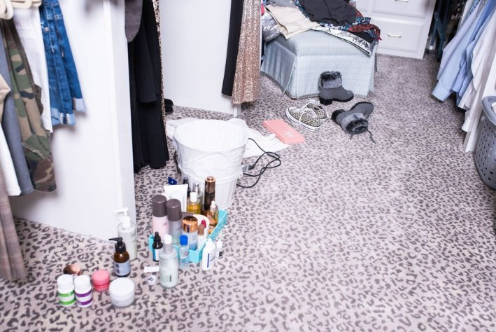 beauty products laying on a closet floor