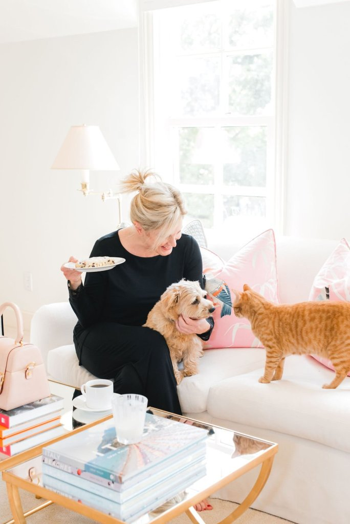 7 Ways to relax | 7 Easy Ways to Relax by popular Dallas life and style blogger, Tanya Foster: image of a woman sitting on her couch with her dog and cat.