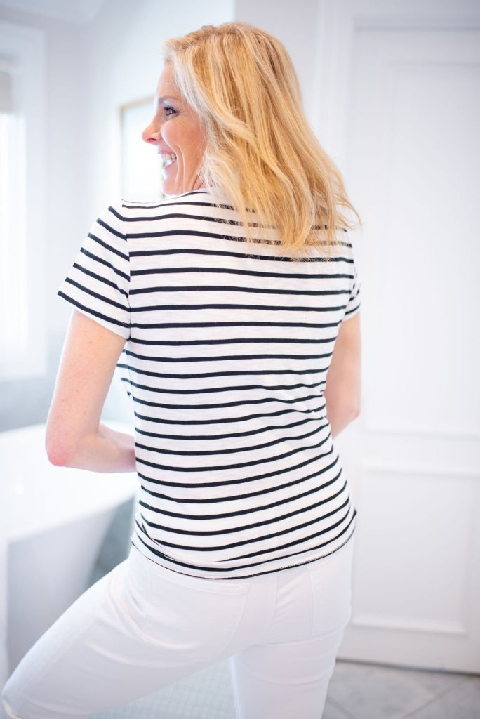 How to stop bra lines from showing with Soma Full Coverage Bra | Eliminate Bra Lines With a Soma Enbliss Bra by popular Dallas fashion blogger, Tanya Foster: image of a woman wearing a white and blue striped skinny tee without bra lines showing.