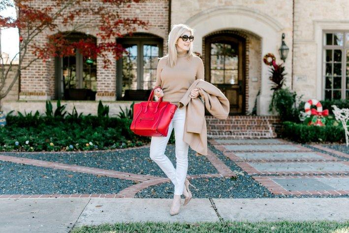 Everlane coat and turtleneck with red Celine bag.