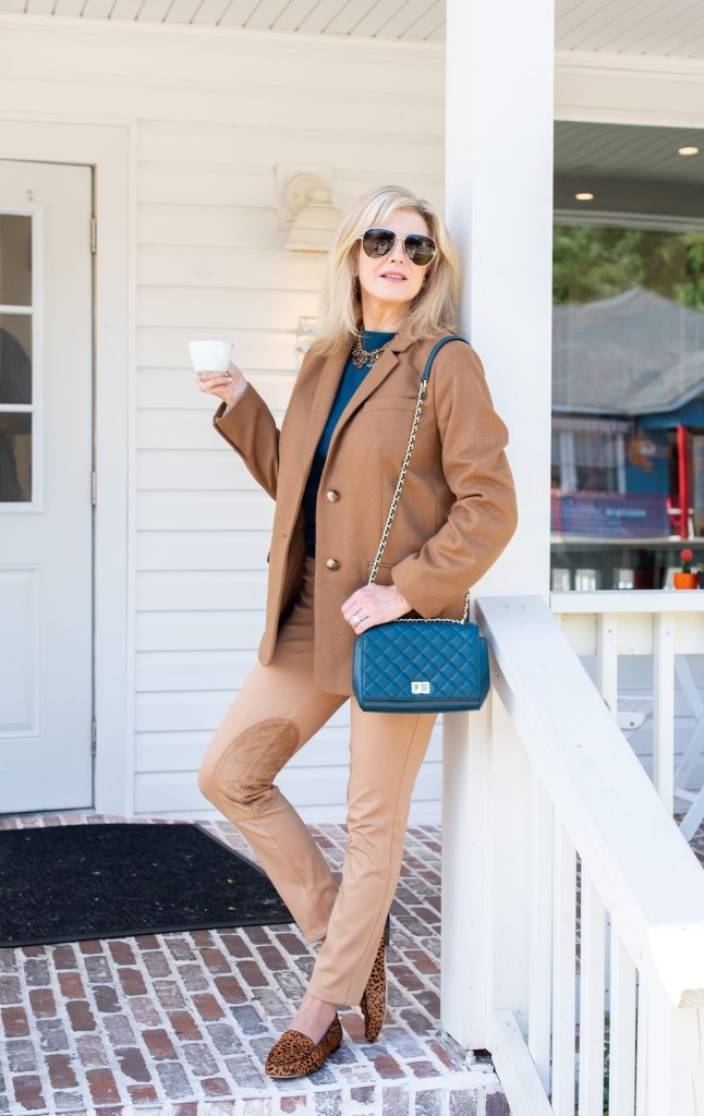 Best Talbot pants for Fall featured by top US luxury fashion blogger, Tanya Foster: image of a woman wearing a Talbots cashmere sweater, Talbots ankle pants, Talbots wool long blazer, Talbots leopard scarf, Talbots quilted shoulder bag, Talbots leopard loafers, Talbots flower necklace.