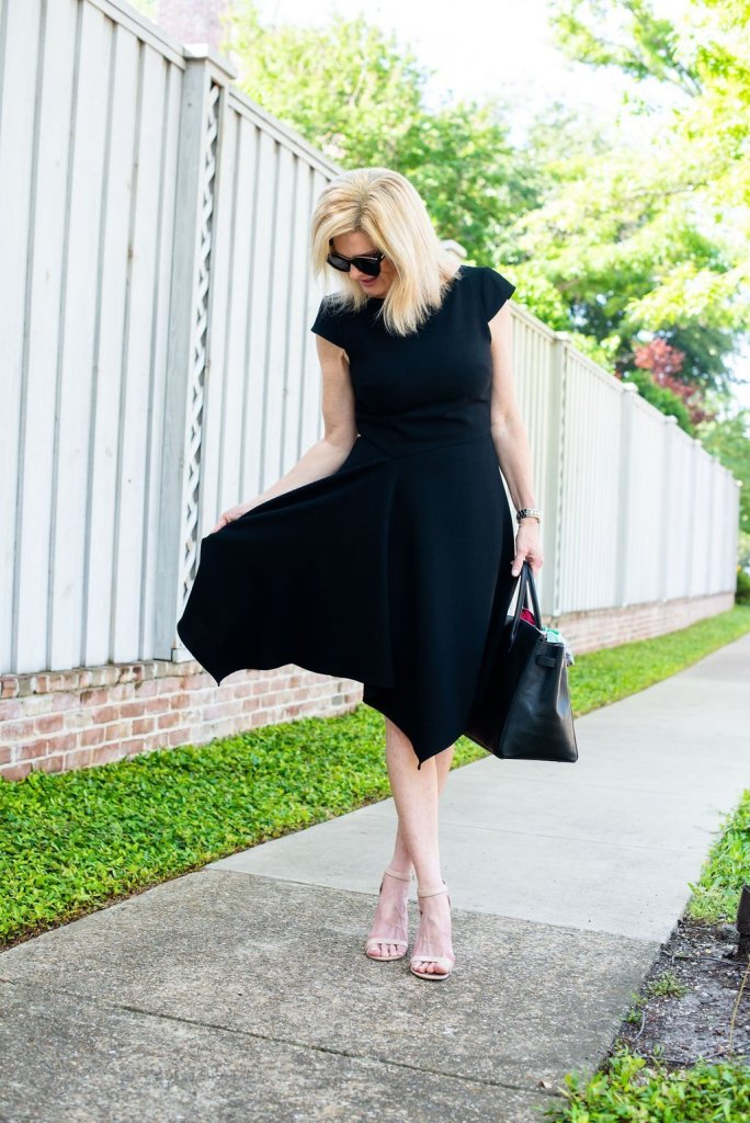 Fit and flare dress flattering to everyone, featuring by top US fashion blogger, Tanya Foster: image of a woman wearing a Harper Rose black fit and flare dress, Le Specs cat eye sunglasses, Yves Saint Laurent Sac de Jour, Christian Dior scarf, and Stuart Weitzman sandals.