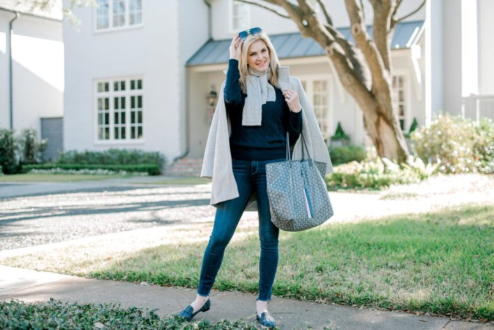 Talbots grey coat over navy cashmere sweater and grey cashmere scarf with jeans.