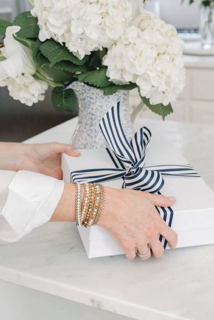 Victoria Emerson | The Columbus Day Victoria Emerson SALE! by popular Dallas fashion blogger, Tanya Foster: image of woman wearing some Victoria Emerson stack bracelets.