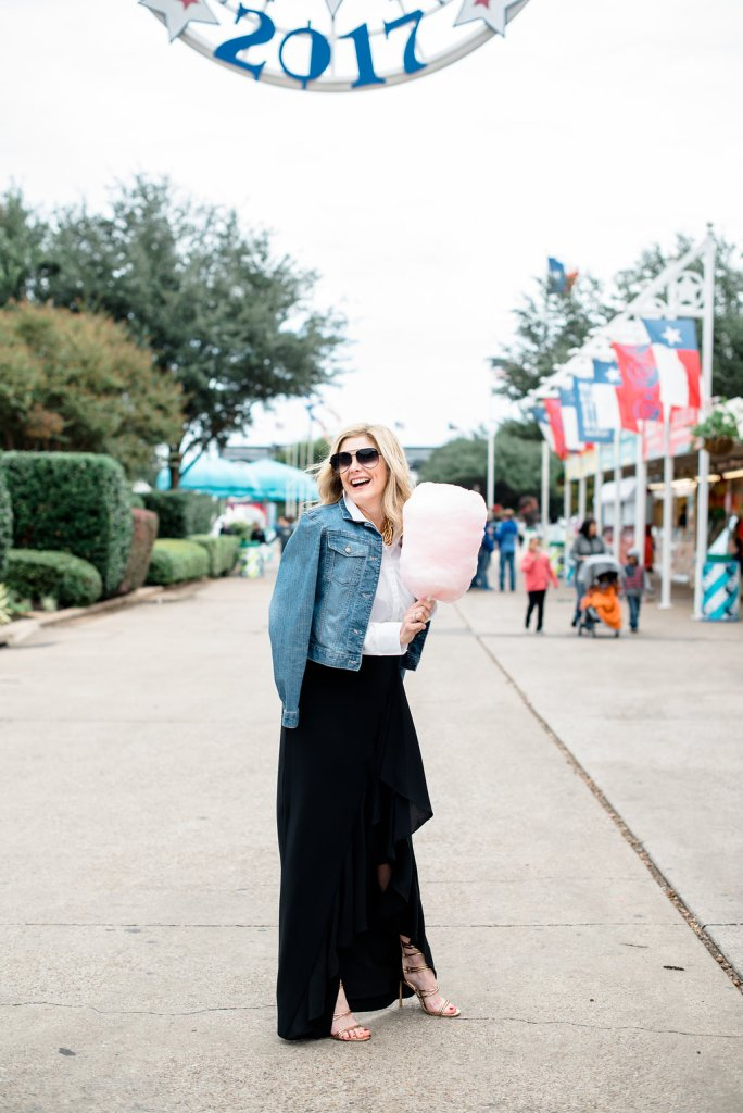 Wearing a denim jacket, long black Eliza J skirt and white button down at the State Fair of Texas