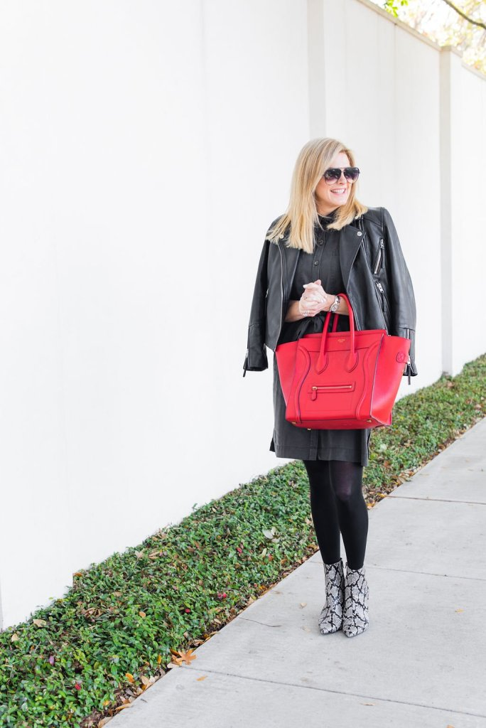 Tanya Foster standing on a sidewalk with a Celine red bag