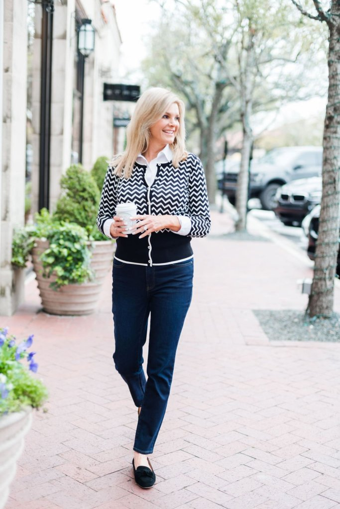 Tanya Foster wearing a TALBOTS X O, THE OPRAH MAGAZINE COLLECTION cardigan, jeans and black shoes